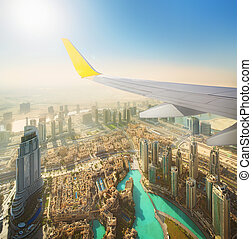 Cityscape of Dubai from aeroplane window, bird view, UAE