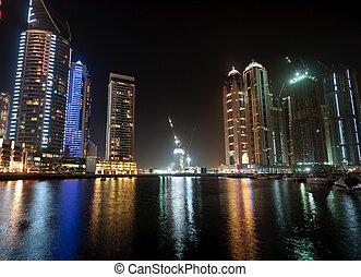 Cityscape of Dubai - Towering city skyscraper blocks in...