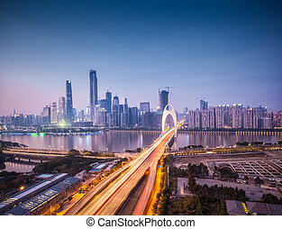 cityscape of guangzhou in nightfall, liede bridge across pearl river to the financial district