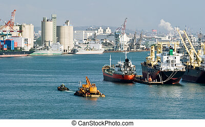 harbor - Cityscape of harbor with freighter on water of...