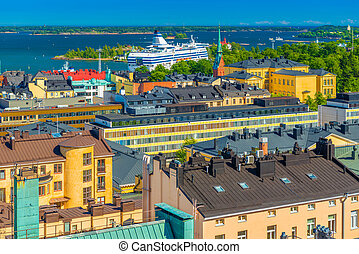 Cityscape of Helsinki, Finland. Colorful houses of the biggest Finnish city. Panorama with a Cruise liner and The Baltic Sea with numerous Islands