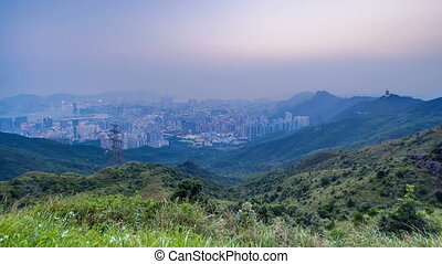 Cityscape of Hong Kong as viewed atop Kowloon Peak with day to night timelapse with Hong kong and Kowloon below