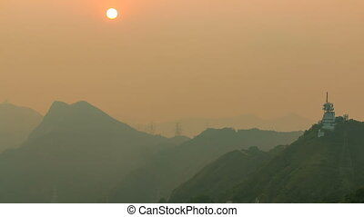 Cityscape of Hong Kong as viewed atop Kowloon Peak with sunset timelapse with Hong kong and Kowloon below