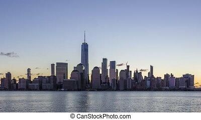 cityscape of lower manhattan new york at sunrise