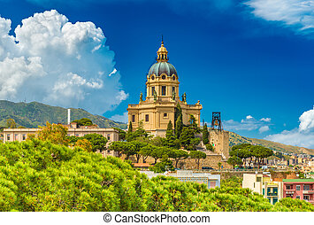 Cityscape of Messina on sunny summer day with beautiful cumulus clouds. View of a yellow Church in Baroque architectural style. Sicily, Italy