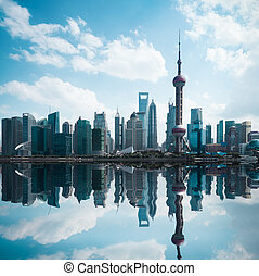 cityscape of modern city with reflection in shanghai -...