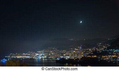 Cityscape of Monte Carlo at night timelapse, Monaco. Moon...