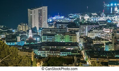 Cityscape of Monte Carlo, Monaco night timelapse with roofs...