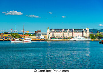 Cityscape of Oslo viewed from the sea, Norway. Skyline of a port city on summer sunny day