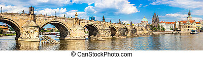Cityscape of Prague. Panoramic view of Karlov or charles bridge and river Vltava in Prague in summer