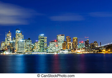 Cityscape of Sydney at sunset illuminated skyscrapers...