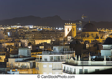 Cityscape of the city of Elche at night.