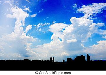 Cityscape Over Cloudy Blue Sky