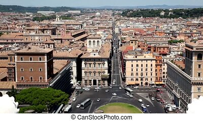 Cityscape Rome above, shows  Piazza Venezia and via del Corso between houses