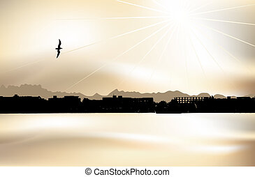 Cityscape silhouette on sunset