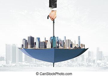 Cityscape upside down umbrella concept