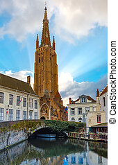 Cityscape with canal Dijver and a Church of Our Lady in...