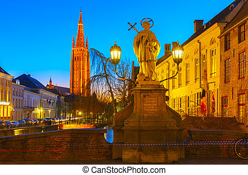 Cityscape with canal Dijver, Bridge St. Nepomuk and a Church of Our Lady in Bruges