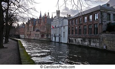 Cityscape with old bridge and typical Flemish houses....