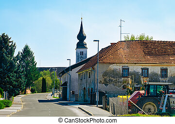 Cityscape with road and church in Slovenia
