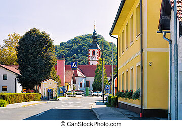 Cityscape with road and church Slovenia