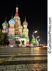 Cityscape with the image of night St. Basil Cathedral in Moscow