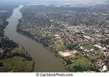 Ciudad del Este, Paraguay - aerial view with river Parana.