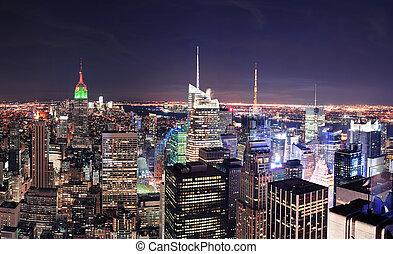 ciudad nueva york, horizonte de manhattan, por la noche