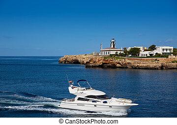 Ciutadella Sa Farola Lighthouse with yatch boat in Balearic ...