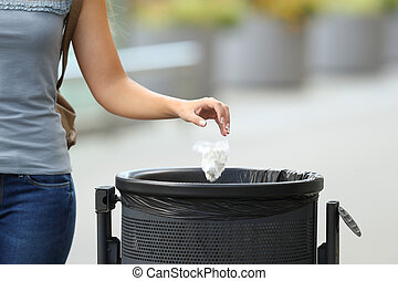 Civic woman throwing garbage in a trash bin - Close up of a...