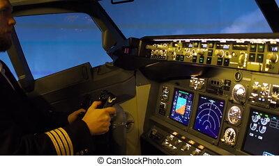 Pilot of passenger aircraft at work. Approaching