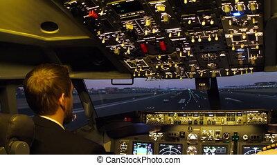 Pilot of passenger aircraft at work. Departure, rotate