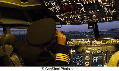 Civil aircraft cockpit. - Pilot of passenger aircraft at...