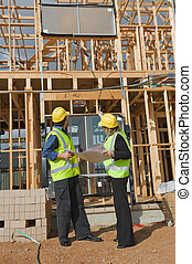 at the construction site - civil engineer and worker ...