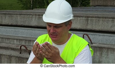Civil engineer blowing nose