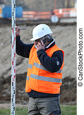 Civil engineer holding an elevation rod