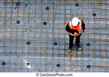 Civil engineer inspecting the work progress in a...