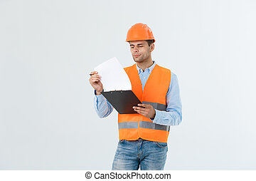 Civil engineer or architech and worker with safety helmet checking building ,engineering and architect concept.