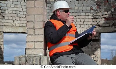 Civil engineer sitting and writing