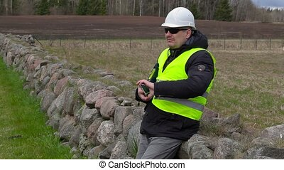 Civil engineer take pictures at place where will new...