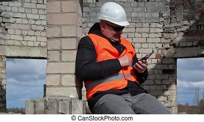 Civil engineer using tablet PC and start laughing