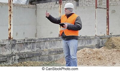 Civil engineer with cell phone near