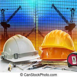 civil engineer working table with safety helmet and writing inst