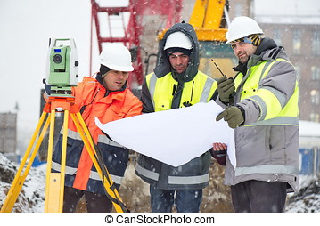 Civil Engineers At Construction Site In Winter Season