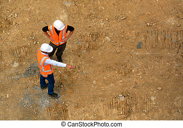 Civil engineers inspecting construction site