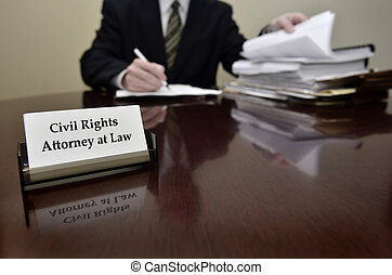 Civil Rights Attorney at Desk with Business Card - Civil...