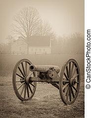 civil war cannon - A civil war cannon with a farm house in...