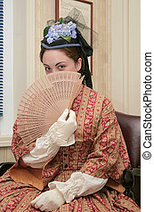 civil war era woman - young woman with a fan dressed in...