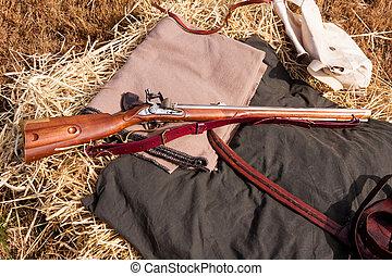 Civil War Rifle - Civil War rifle laying on a bedroll