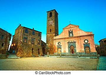 Civita di Bagnoregio ghost town landmark, medieval village square and church view on twilight. Lazio, Italy, Europe.
